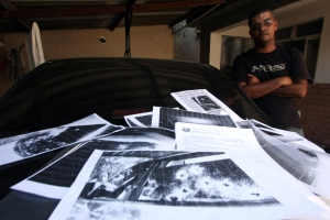Ao ser informado de que estava sendo procurado pelo grupo em viaturas oficiais da Polícia Civil, André Luiz pediu ajuda à Polícia Militar