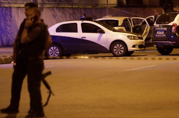 A police investigator inspects the car where Rio de Janeiro city councilor Marielle Franco was shot dead in Rio de Janeiro